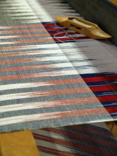 Weaving, weaving, weaving... I wasn't kidding. These scarves are huge! Sweet on-loom hemstitching to secure the fringe. No knots on...