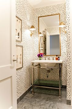 """Wallpaper isn't off the table in a room short on light. For small spaces like hallways and powder rooms, Bunn likes to use a lively print set on a white background, like this Brunschwig & Fils pattern, Les Touches Black. """"This makes the room feel bigger and brighter, because the light reflects off the white,"""" she says."""