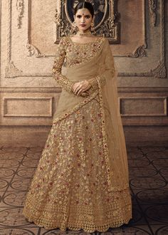 Beige net semi stitch lehenga with net choli. This lehenga choli is embellished with resham, stone and dori work. Product are available in 32 to 58 sizes. It is perfect for Bridesmaid Wear, Guest of Wedding Wear, Party Wear, Wedding Wear. Lehenga Anarkali, Indian Lehenga, Silk Lehenga, Anarkali Suits, Lehenga Top, Sharara Suit, Lehenga Choli Online, Ghagra Choli, Bridal Lehenga Choli