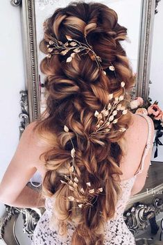 When looking through wedding hair styles, every bride-to-be searches for the one – unique, most flattering, flawless, and long-lasting. Click to start browsing our gallery! #weddinghairstyles