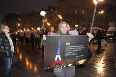 NCRI - Supporters of the National Council of Resistance of Iran (NCRI) held torches at a vigil in Paris' Place de la République on Thursday, November 19 in memory of the 129 people killed in the French capital on November 13 in a spate of armed at...