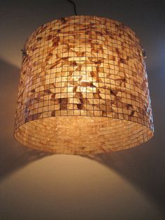 This lampshade is 100% handcrafted with recycled coffee filters in their natural stained color. It can be used both with lamp bases and with a ceiling cord set as a pendant.