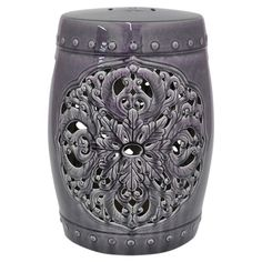 Showcasing an eye-catching floral cutout and purple finish, this ceramic stool brings classic appeal to your entryway or living room.  ...