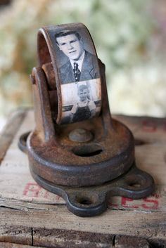 old caster wheel with vintage photos for a paper weight