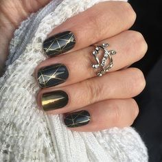 Classy black mani! Jamberry's Brooklyn Bridge and Dipped in Gold wraps with TruShine clear coat to make it super shiny! Shop at cuteclassyjams.jamberry.com - Photo from enjoyyournails