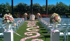 Designed by Fleurie of Reedley California, Wedding Ceremony aisle with petals placed in scrolls pattern. This takes a minimum of 400 roses