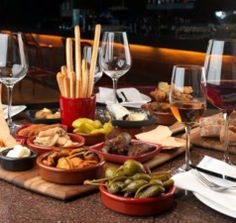 The term tapas narrowly refers to a type of Spanish cuisine, but it is also used more broadly to refer to any similar format dining. This is referred to more formally as small plates, but tapas is common. Such dishes are traditionally common in many parts of the world, and have become increasingly popular in the English-speaking world since about 2000, particularly under the influence of Spanish tapas.
