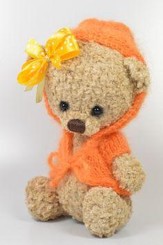 teddy in orange sweater