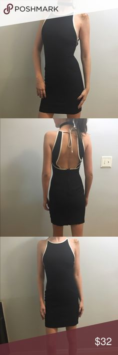 """Vintage Backless Dress Tight fitting black dress with white detailing. Backless, and ties at the top. I'm 5'7"""" for reference. Tag says size 3/4, 26"""" waist.   ***   ***   ***   ***   *** • NO SWAPS • Please message me with any and all inquiries • MAKE ME AN OFFER! Please no lowballing.  • Discounts on bundles! However, I DO NOT except offers on bundles as they are already discounted :) • Smoke-free house • No returns  :) Vintage Dresses Backless"""