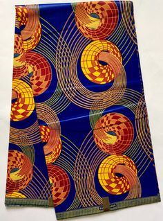 A personal favorite from my Etsy shop https://www.etsy.com/listing/497675839/african-print-fabric-ankara-blue-red