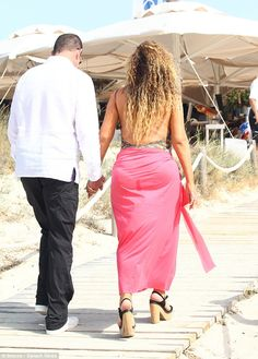 Solid ground: The couple reached the wooden path that led to the restaurant which made for easier walking for Mariah and those heels
