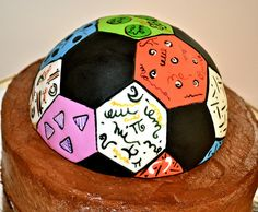 edible fondant britto themed soccer ball on chocolate cake