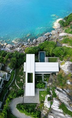 Villa Amanzi - LOVE this view of this house, the straight vs the curved lines, the ocean, the rock cliffs, the shelter vs the openness. I love all other pics I've seen of this house as well