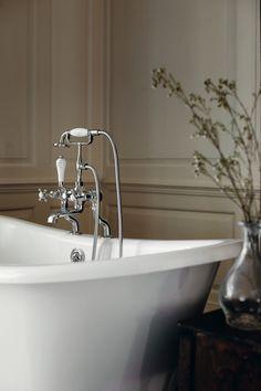 Wood panelled bathroom with slipper bath