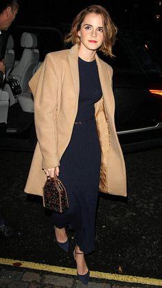 Emma Watson in a camel coat and a navy Gabriela Hearst dress
