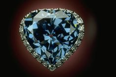 The Blue Heart Diamond photo shown here set in a platinum ring surrounded by 25 white diamonds. The stone measures 20.01 mm wide, 19.99 mm tall and 11.89 mm deep