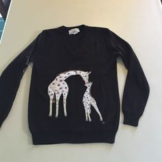 "giraffe chocolate brown sweater M Cyn Les Shirlee Super cute!!! Vintage chocolate brown embroidered giraffe sweater 100% acrylic. It is in great shape, some piling, but not noticable. The sleeve is embroidered"" it isn't necking, it's mother love!"" Shirlee Sweaters Crew & Scoop Necks"
