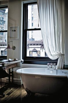 V cool bathroom. Wait. Is that a desk in the bathroom? There's glass there. Not sure the practicality of this situation, but I do dig the tub and window. : The Black Workshop