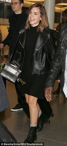 Strong look: Sporting an edgy black leather jacket over a matching black dress, Harry Pott...