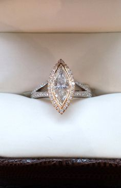 Check out this Pink Colored Marquise Diamond with a Rose Gold Halo. This Diamond Engagement Ring is to die for!  http://www.glatzjewelers.com/