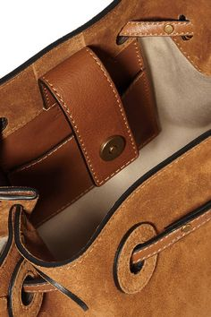 Tan suede and leather (Calf) Snap-fastening tab at open top Comes with dust bag Weighs approximately 1.1lbs/ 0.5kg Made in Italy