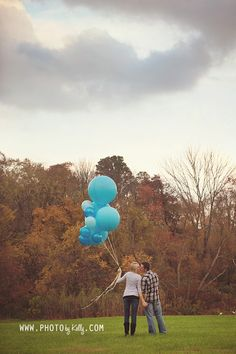 Simple gender reveal with big balloons.
