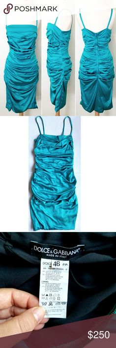 """Dolce & Gabanna Silk Dress Gorgeous turquoise ruched dress in stretch silk. Lined, hidden back zipper closure.  18"""" across chest,  33"""" long pit to bottom hem, straps are 7.5"""" long. Size is 46 Italian, equivalent to 10. In excellent condition.    P.S the straps have been alternated in the back and one corner has come off slightly (see last pic) totally invisible and irrelevant,  just wanted to mention it. Dolce & Gabbana Dresses"""