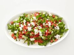Watermelon-Cucumber Salad : Turn diced watermelon into a savory side salad by tossing it with cucumber, scalions, minced jalapeno and feta cheese.