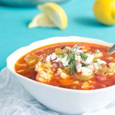 Homemade Greek fish soup, made in just 15 minutes. Fresh fish, peppers, onions, and tomatoes, along with Greek olives and feta cheese.