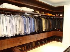 Custom Closet-MENS Walk in-This is an easy wrap model, and the only kind I like.  Because of the designers attention to detail, ALL the items are easy to see & reach. SUPERIOR.  Many designers force you to use vertical drawers, note the flow of these drawers, excellent use again.  A++