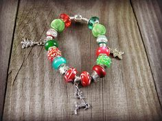 Holiday Charm Bracelet Tibetan Charm Euro Charm Bracelet Euro Beads Bracelet on Snake Chain Tree Reindeer Gingerbread Charms Green Red Beads #bestofEtsy #etsyfinds