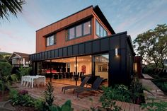 For the owners of this Auckland house, maximising the site to gain a variety of living spaces was a necessity.