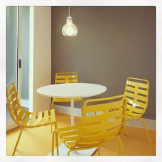 A small meeting room is given greater presence with the bold yellow carpet and spine back chairs.