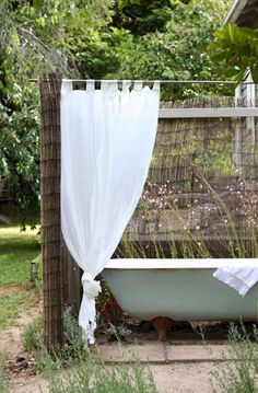 Simple, lovely outdoor tub and shower.