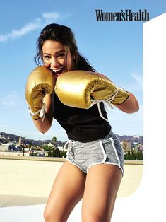 Packing a punch: Gina grinned playfully as she assumed a boxing stance...