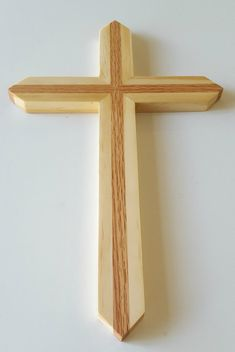 Handmade large sized red oak and pine wooden wall cross. approximately 15 tall x 9 wide x 5/8 thick. Hand rubbed Danish oil finish. Sawtooth hanger on back. Makes a great gift for Christmas, baptism, house warming, weddings, etc. Grain patterns vary. Made to order, usually ships in 3 to 5 business days. Made with care in the USA.  Take 5% off orders of $50 or more, use coupon code: 5PER50 Take 10% off orders of $75 or more, use coupon code: TENOFF75 Take 15% off orders of $150 or more, u...