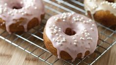 Bloggers Adam and Joanne Gallagher from Inspired Taste make easy doughnuts from Pillsbury® Grands!® biscuits. Glazed in pink and yellow, they're perfect for spring!