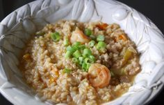 Recipe: Easy Jambalaya - 100 Days of Real Food.  I'm using chicken Andouille sausage, shrimp and chicken instead of the oysters.  And canned tomatoes.