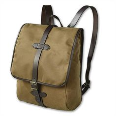 Tin Cloth Backpack by Filson is fully lined and water resistant with a padded back and leather straps. It even has a detachable iPad case! MADE IN THE USA.