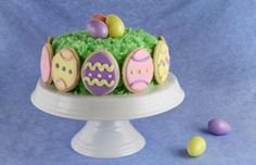 Easter Sunday Carrot Cake ~ Easter favorites (decorated Easter egg cookies and carrot cake) combine to make an over-the-top party cake.
