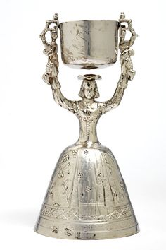 Wager cup, Joseph Walker, Dublin, Ireland, 1706-7, Silver  [Museum no. M.1643-1944]  Drinking games were sociable activities that tested the skill and dexterity of the participant. The silver wager cup challenges co-ordination. While draining liquid from the milkmaid's skirt, the drinker must balance the full pail below to avoid an embarrassing soaking.The art of drinking - Victoria and Albert Museum