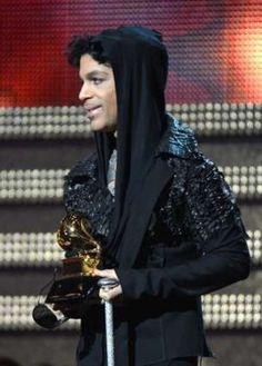 Photo taken on February 10, 2013 shows musician Prince as he presents the winner for Record of the Year during the 55th Grammy Awards in Los Angeles, California.