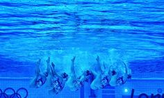 I've been photographing synchronised swimming through one of the underwater windows in the  Aquatic centre today. Here Team GB their technical routine. Taken on my IPhone 4S using Snapseed.