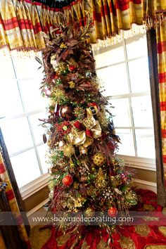 Christmas Tree with rich chocolate browns, animal prints and pops of red  www.showmedecorating.com