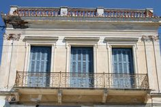 Picture of Neoclassical architecture typical for Poros - Greece - Europe Poros Greece, Neoclassical Architecture, Athens, Around The Worlds, Europe, Windows, Island, Mansions, House Styles