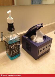 Get rid of the cheesy JD bottle. I want the GameCube Kleenex box. More memes, funny videos and pics on Kleenex Box, Hipster Bathroom, Man Cave Bathroom, Guys Bathroom, Nerd Cave, Video Game Rooms, Geek Decor, Man Decor, Ideas Hogar