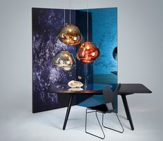 MELT By Tom Dixon  |  Tom Dixon collaborated with design collective FRONT to create MELT, a new distorted globe light made from blown-glass
