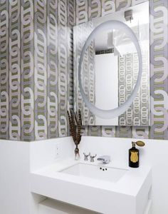 Wallpaper can - and is- being used for a dramatic flair in bathroom remodeling (this Bold Geometric Wallpaper is an example). Do you like it?