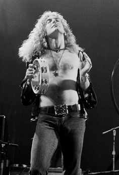 Robert Plant of Led Zeppelin - I really can't mention what I dreamed of doing if I ever were with him.....or Page. Of course I never got the chance...but I did dream! :)