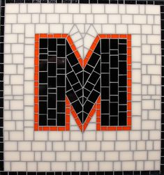 Mosaic Letter M - The Tieton Alphabet  Tieton Mosaic is a mosaic sign company in Tieton, WA specializing in typographic glass mosaic signage